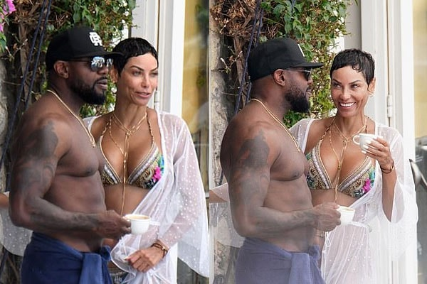 Antoine Fuqua and Nicole Murphy kiss