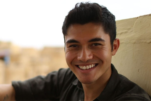 Henry Golding as a TV host